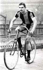 Arthur Linton in a striped shorts and top cycling