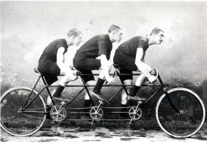 Jimmy followed in Arthurs path, even having the same coach. Pictured on a triple tandem, Jimmy, Morgan Thomas and Arthur Linton