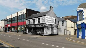 black and white photo of Morris Jacobs shop imposed on modern street image