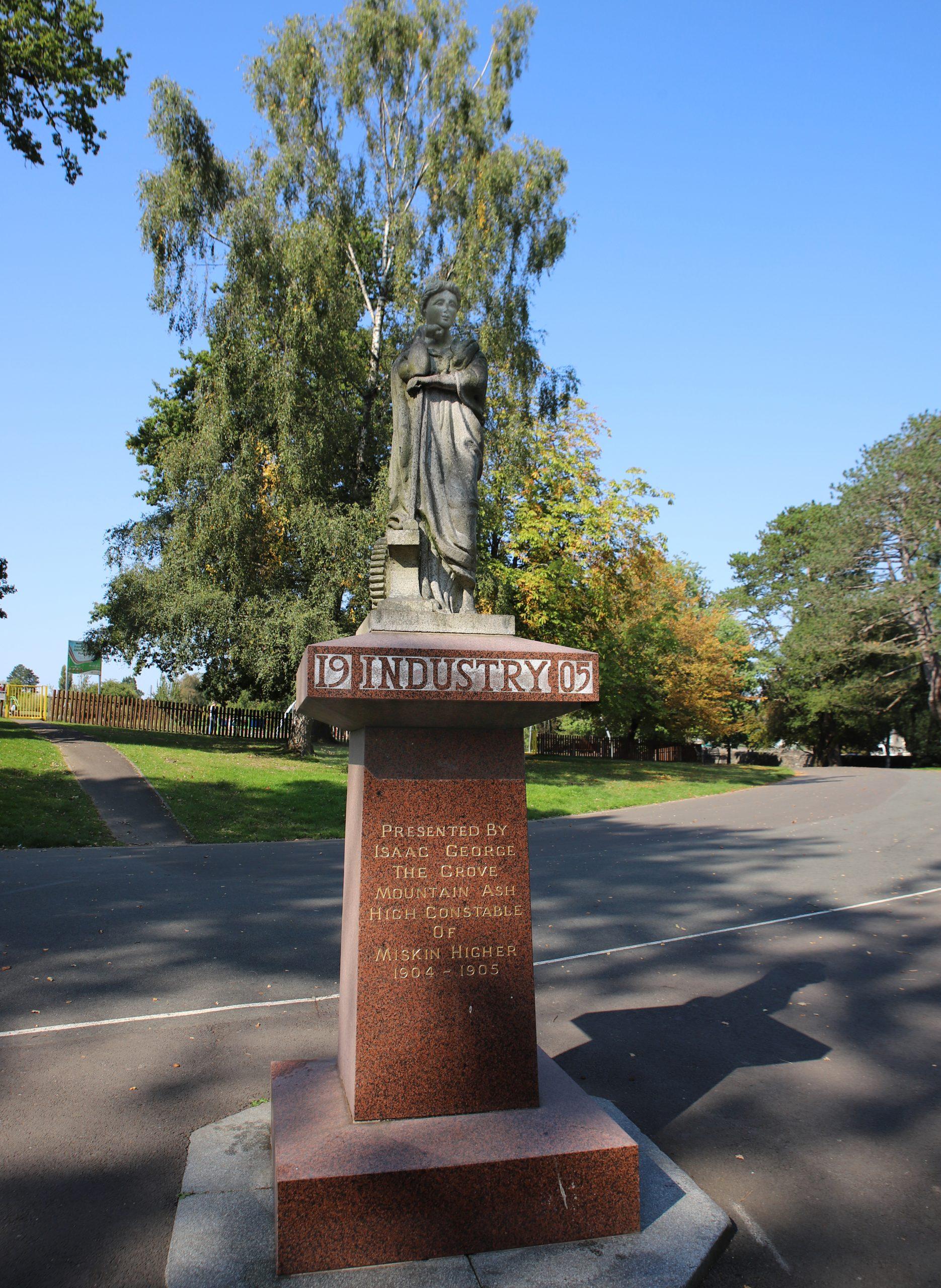 Statue of figure on earthy coloured plinth