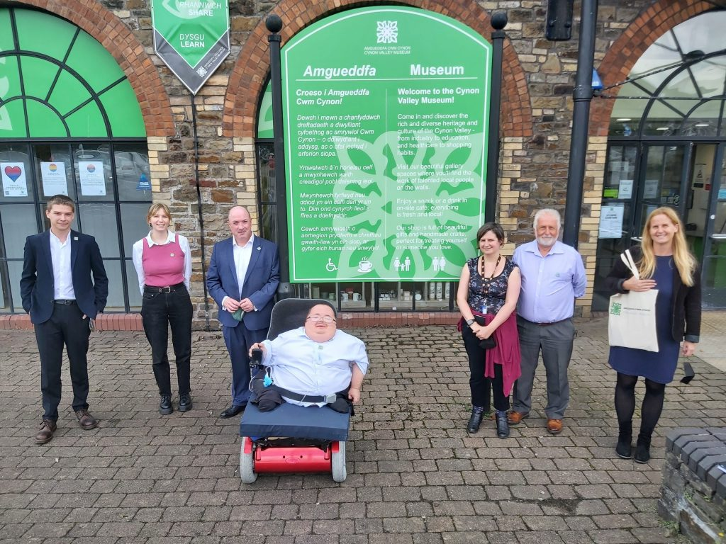 Beth Winter Visits Cynon Valley Museum, with staff and trustees stand for photo with Beth outside of the museum building