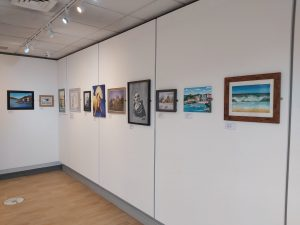 Lower Gallery with art on white walls