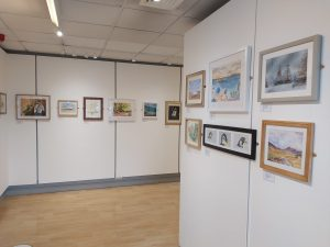 Lower gallery, white walls with artworks on them