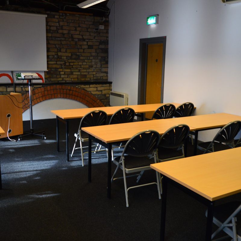 Exposed stone and brickwork with room set up like a classroom